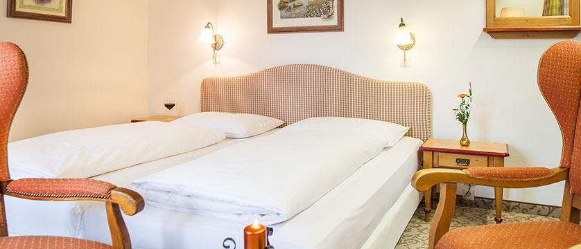 Landhotel St. Georg, Zell am See, Austria - austrian twin bedroom interior.jpg